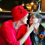 Mary and Dena Kleinsorge share a birthday kiss
